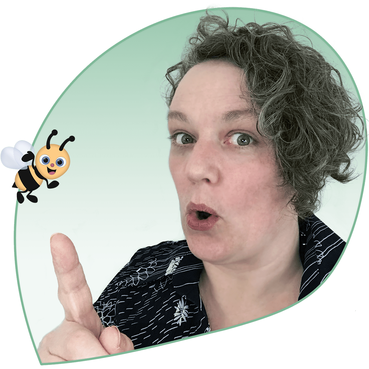 Colette looks at the camera while pointing at Bee